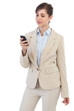 Businesswoman posing with phone Stock Photo
