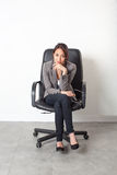 Businesswoman posing sitting in office chair for first job Stock Photo