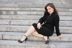 Businesswoman posing on steps Stock Photo