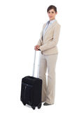 Businesswoman posing with suitcase Stock Photography