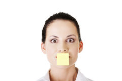 Businesswoman with post it card on mouth Stock Images