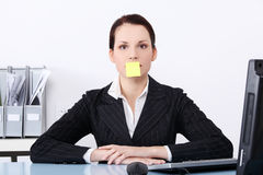 Businesswoman with post it note on her mouth. Stock Images
