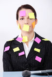 Businesswoman with post it notes on her body. Stock Photography