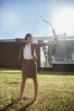 Businesswoman Practicing Archery Stock Photos