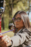 Businesswoman Practicing Archery Royalty Free Stock Photos