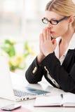 Businesswoman praying. Royalty Free Stock Image