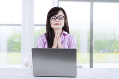 Businesswoman praying while working 2 Royalty Free Stock Photography