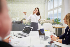 Businesswoman in a presentation Stock Image