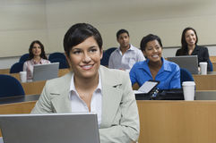 Businesswoman In Presentation With Colleagues royalty free stock images