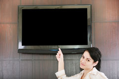 Businesswoman presentation with lcd tv Stock Photo