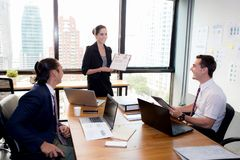 Businesswoman presentation to a group in meeting. The businesswoman presentation to a group in meeting royalty free stock image