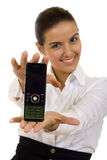 Businesswoman Presenting A Mobile Phone Stock Photo