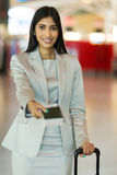 Businesswoman presenting air ticket Stock Photography