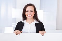 Businesswoman presenting blank billboard Stock Photography