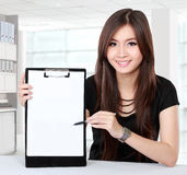 Businesswoman presenting blank document Stock Photos