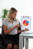 Businesswoman presenting chart Stock Photography