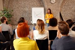 Businesswoman presenting chart to coworkers Royalty Free Stock Photo