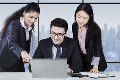 Businesswoman presenting document on laptop Royalty Free Stock Photography