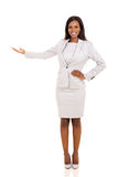 Businesswoman presenting empty space Stock Photography