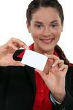 Businesswoman presenting her card. Stock Images