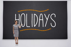 Businesswoman presenting holidays Stock Photo