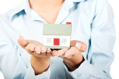 Businesswoman presenting a house model. Royalty Free Stock Photos