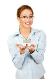 Businesswoman presenting a house model. Stock Photo