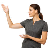 Businesswoman Presenting An Imaginary Product Royalty Free Stock Photography