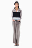 Businesswoman presenting laptop royalty free stock images