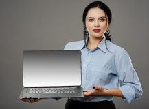 Businesswoman presenting a laptop Stock Photo