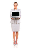 Businesswoman presenting laptop Stock Photo