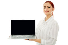 Businesswoman presenting laptop's screen Royalty Free Stock Photography
