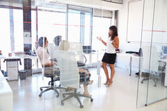 Businesswoman presenting meeting in an office Stock Photography