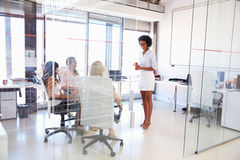 Businesswoman presenting meeting in an office Stock Image