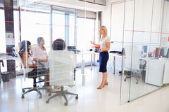 Businesswoman presenting meeting in an office Stock Photo