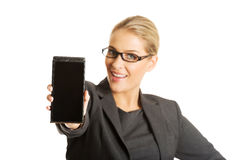 Businesswoman presenting mobile phone Stock Photography