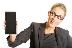 Businesswoman presenting mobile phone Royalty Free Stock Photo