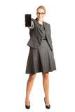 Businesswoman presenting mobile phone Royalty Free Stock Photos
