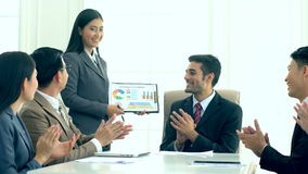 Businesswoman presenting new project plan at a meeting room stock footage