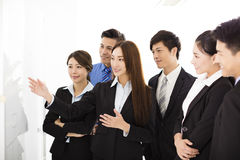 Businesswoman presenting new project to partners in office Royalty Free Stock Photography