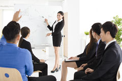 Businesswoman presenting new project to partners in office Royalty Free Stock Photos