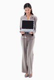 Businesswoman presenting notebook Stock Photo