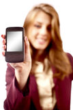 Businesswoman presenting PDA or smartphone Stock Image
