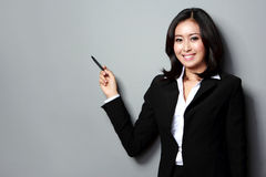 Businesswoman presenting Stock Photography
