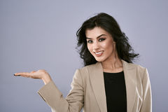 Businesswoman presenting product Royalty Free Stock Photography