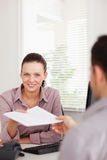 Businesswoman presenting someone a contract Stock Photo