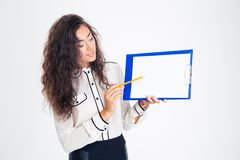 Businesswoman presenting something on clipboard Stock Photo