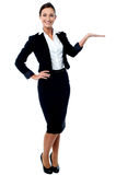 Businesswoman presenting something Stock Photo