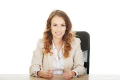 Businesswoman presenting something in hands. Royalty Free Stock Image