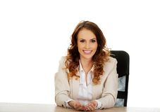 Businesswoman presenting something in hands. Royalty Free Stock Photography